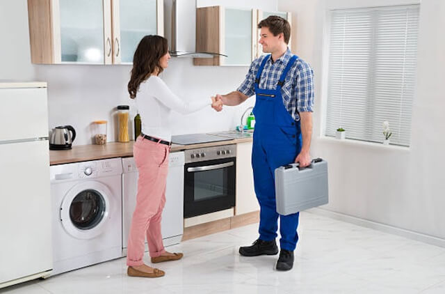 appliance repairman with customer in green bay